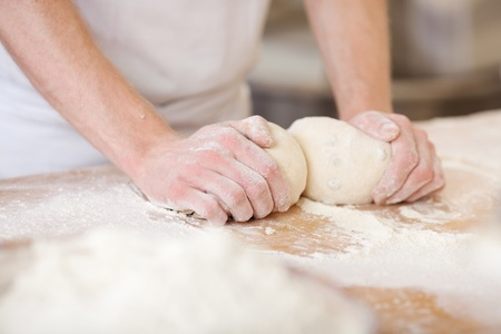 Baker making bread, man hands, kneading dough, cooking coat