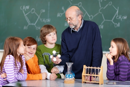 instructing: Portrait of teacher instructing students learning molecules