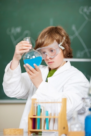 Young student checking the liquid formula inside the lab photo