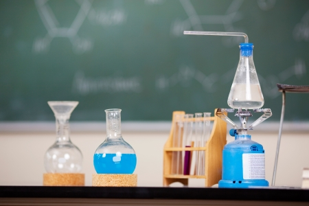 chemistry lesson: Chemistry laboratory glassware with liquid formula at the laboratory Stock Photo