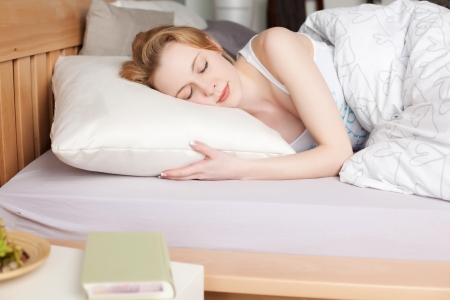 Portrait of sleeping female with book on the table Stock Photo - 21279706