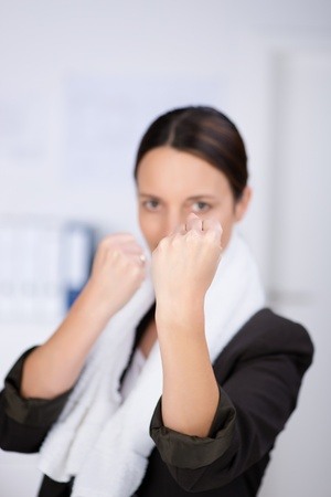 ultimatum: Portrait of angry businesswoman with fists in office