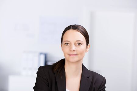 Portrait of confident serious businesswoman in office photo