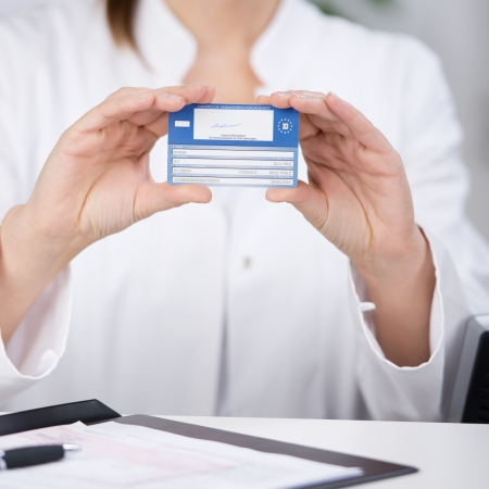 Midsection of receptionist showing medical card at counter in hospital Stock Photo - 21290102