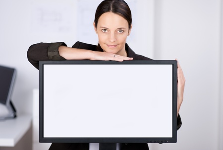 Portrait of confident businesswoman with LCD screen in office photo