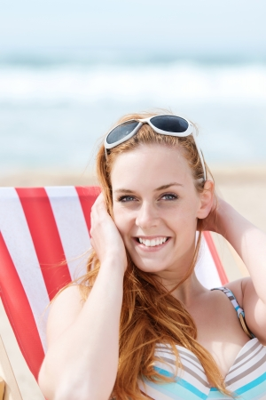 Portrait of a smiling young woman in relaxing at the beach Stock Photo - 21290408
