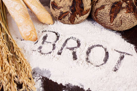 Brot, written in flour and assortment of breads photo