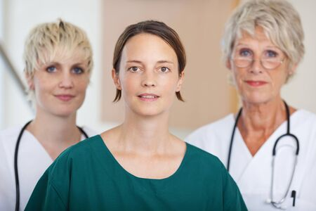 gastroenterologist: Portrait of confident serious medical team of doctors together in clinic