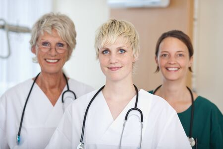 Portrait of confident medical team of female doctors in clinic photo