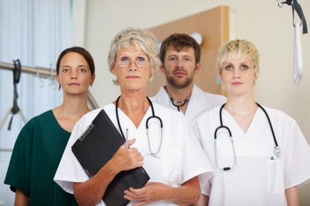 Portrait of confident doctors team together in clinic photo
