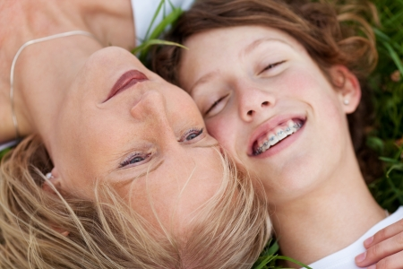 close-up view of mother and daughter lying close together Stock Photo