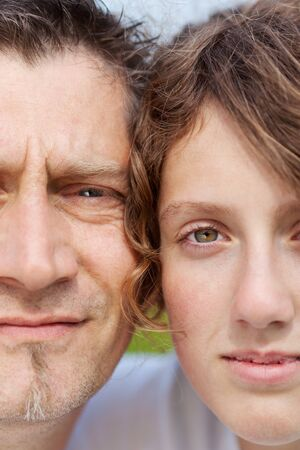 portrait of father and daughter close together photo