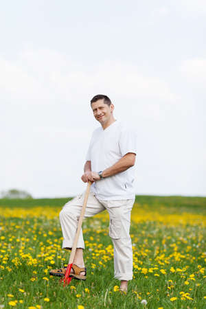 man standing on green field with a spade Stock Photo - 21301530