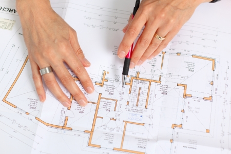 woman´s hands with pencil and construction plans Stock Photo
