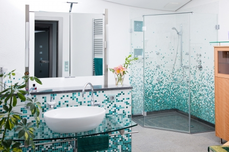 view on modern bathroom with glass shower cabin