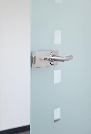 modern glas door and metalic door´s handle