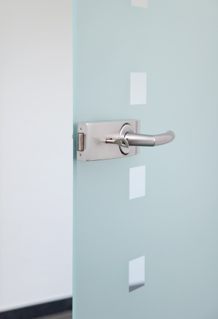 open doors: modern glas door and metalic door´s handle Stock Photo