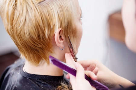new haircut for blond woman in salon Stock Photo - 21301307