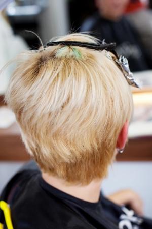 hair treatment: blond woman waiting for hair treatment in hair salon