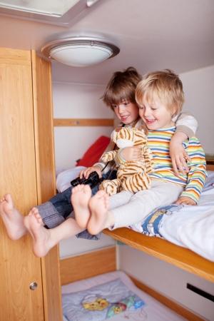 Two happy little boys in a caravan photo
