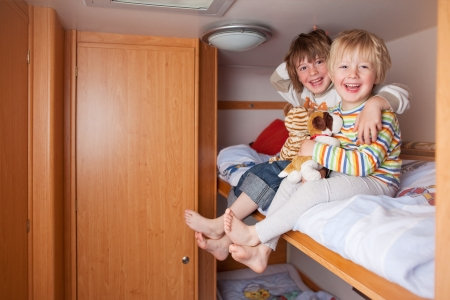 rv: Two laughing little boys in a caravan