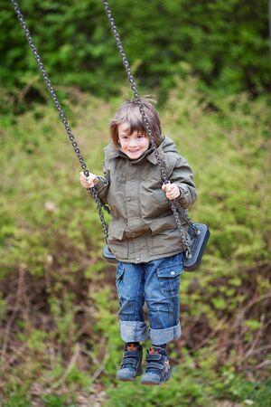 full metal jacket: Full length of cute boy swinging in park