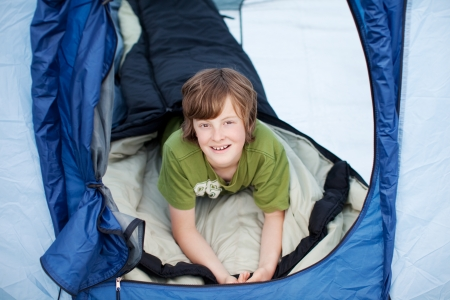 preadolescent: Portrait of preadolescent boy lying in tent