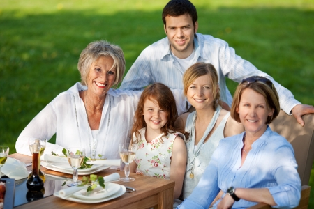 Group portrait of happy multi generation family smiling together at dining table Stock Photo - 21302075