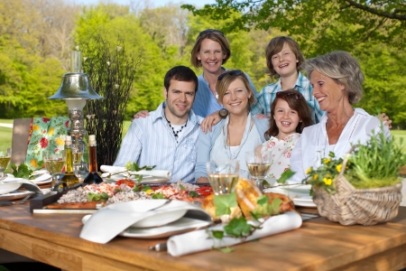 countryside: Portrait of happy family having picnic in the garden