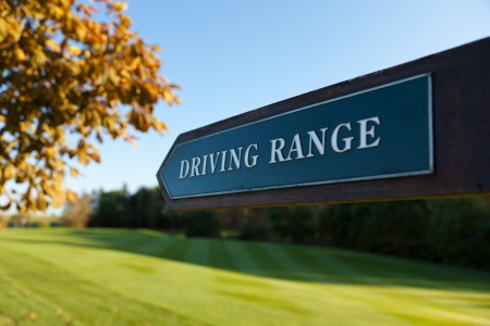 driving range: Driving Range direction sign at a golf course Stock Photo