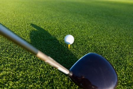 Closeup of golf club and ball photo