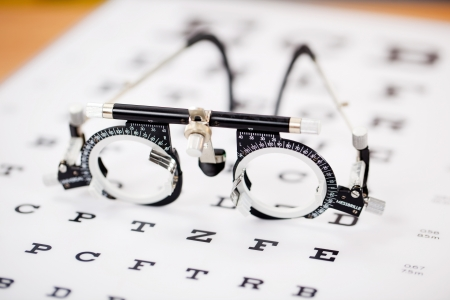 ophthalmic: Closeup of eye test glasses on Snellen chart