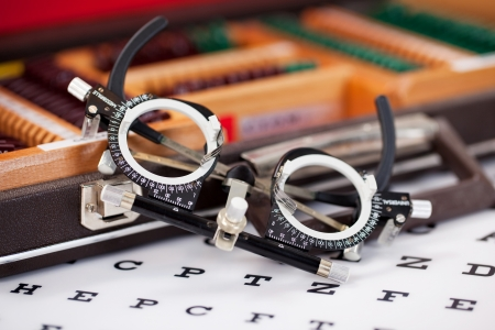 diopter: Closeup of eye examination glasses on Snellen chart