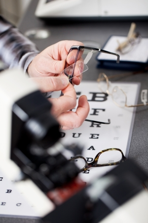 close up view of an optician repairing glasses photo