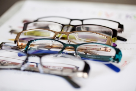 spec: Closeup of new glasses displayed on paper Stock Photo