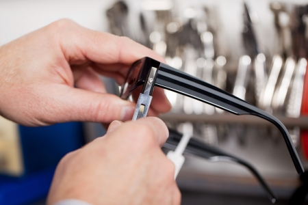 close up view of an optician fixing frame photo