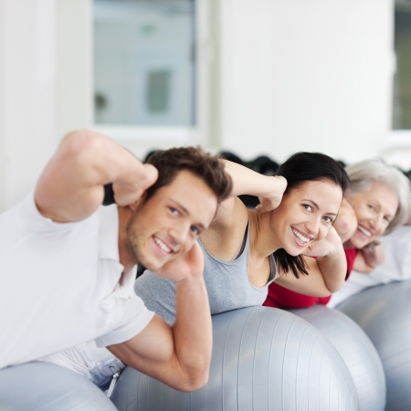 daughter in law: Portrait of happy family exercising on Swiss ball Stock Photo