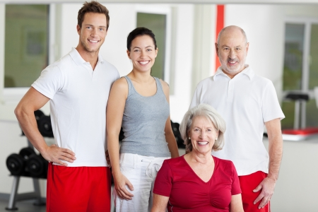 mother in law: Portrait of family of four smiling together in gym