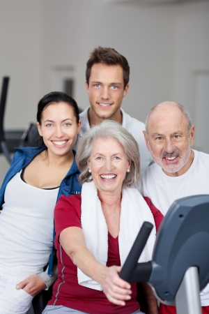 Portrait of fit family smiling together in gym photo