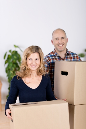 Portrait of couple carrying cardboard boxes at new home Stock Photo - 21315866