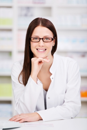 Portrait of young health care worker and background pharmacy photo