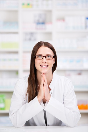 Smiling health care worker with glasses in a praying gesture Stock Photo - 21341165