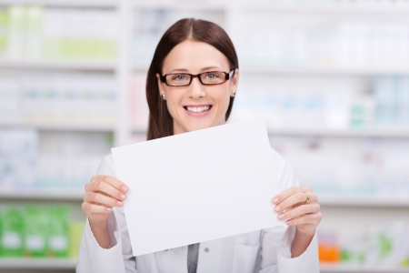 Beautiful Pharmacist woman smiling and showing the prescription Stock Photo - 21341167