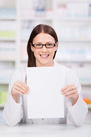 hospital staff: Smiling woman health care worker showing the prescriptions Stock Photo