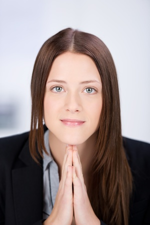 Portrait of an attractive young business woman trying to concentrate. photo