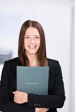 Portrait of smiling businesswoman holding a document Stock Photo - 21341224