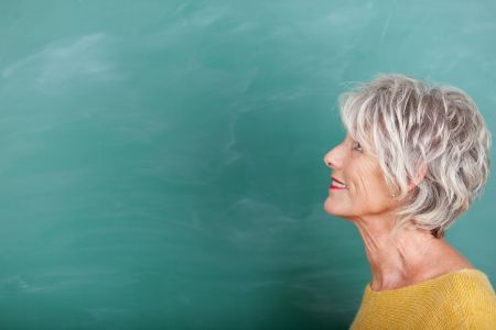 adult profile: Attractive mature woman looking up and thinking Stock Photo