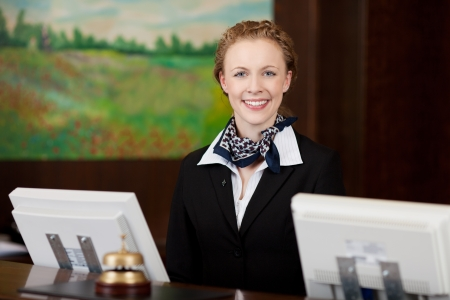 Caucasian happy woman working as a professional receptionist in a hotel photo