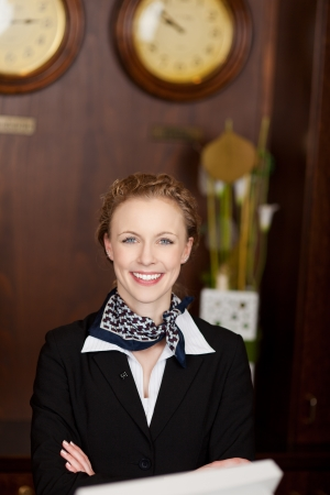 Portrait of a beautiful Caucasian woman working as receptionist ready to welcome tourists photo