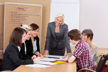 office presentation: A group of professional people having a meeting in conference room Stock Photo